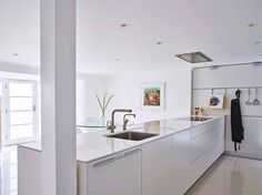 Find out how we designed a crisp white kitchen, laundry room and shower/wash down area for this stylish coastal home with beach access in East Devon. Kitchen Interior, Kitchen Decor, Kitchen Design, Exeter, Coastal Homes, Kitchen And Bath, Kitchen Organization, Beach House, Living Spaces