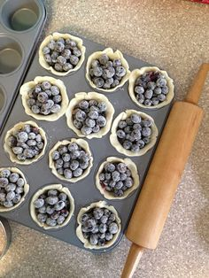 making mini blueberry pies!