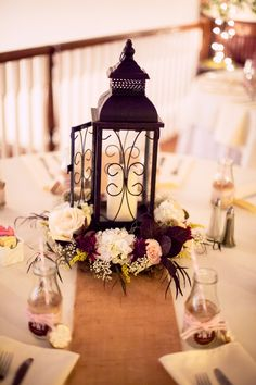 Charming + quaint, these lanterns looked so romantic as centerpieces with flowers.