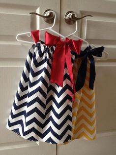 Chevron flowergirl dress with Large satin bow ... Maybe navy blue stripes with an orange stripe?