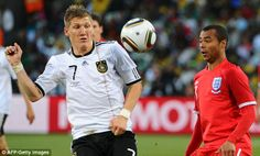 On the ball: Bastian Schweinsteiger competes for the ball with Ashley Cole during Germany'...