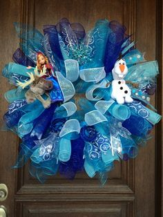 Frozen theme featuring Anna, Olaf and Sven. 32 wide. Fun, bright, with loads of ribbons.  Etsy