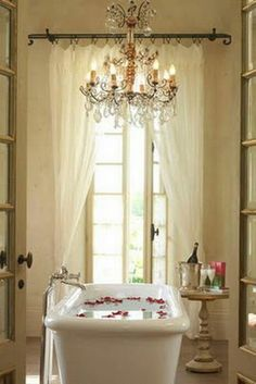i think every master bathroom should have a chandelier.... SO pretty!