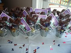I made these adorable horse party favors for my daughter's 8th birthday. The favors featured a delicious horse chocolate lollipop in a silver horse pail embellished with a custom thank you card and gold horse shoe charm.