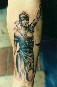 Blind Lady Justice Tattoo On Arm