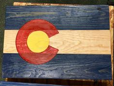 Colorado flag made from beetle kill pine