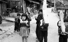 Japanese kids playing outside. Vintage black and white photo.
