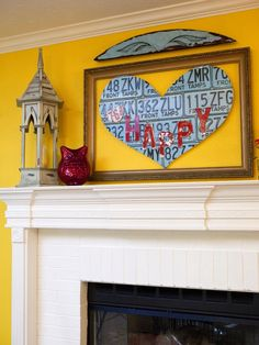 FROM the BIG HAPPY FAMILY episode on HGTV . . license plate heart above the mantel!   {junk gypsy co, http://gypsyville.com/ }