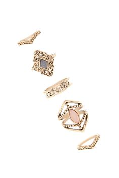 A set of five midi and regular high polish rings with a faux gemstone ring with cutouts, a filigree ring with a faux gem, a geo cutout ring, two chevron shaped midi rings, and all featuring a burnished design.