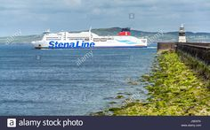 Download this stock image: The Stenaline ferry passing the Holyhead breakwater before heading for Ireland. - J9EKFK from Alamy's library of millions of high resolution stock photos, illustrations and vectors.