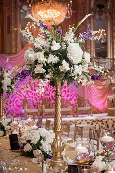 Tall floral centerpieces. in Chicago, IL Pakistani Wedding by Maha Studios | Maharani Weddings
