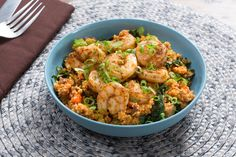 North African-Spiced Shrimp & Couscous with Dates, Kale & Carrots. Visit https://www.blueapron.com/ to receive the ingredients.
