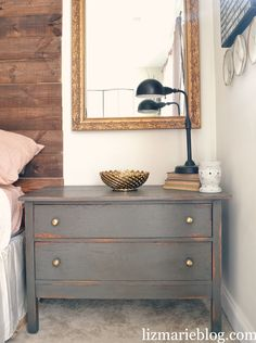 The color I used for these nightstands is Urbane Bronze by Sherwinn Williams. It's a beautiful warm brown with gray undertones. I used Annie Sloans dark wax over these pieces to seal them. I love how the distressing and dark wax accented the beautiful color by Sherwinn Williams perfectly to give it that rustic touch…