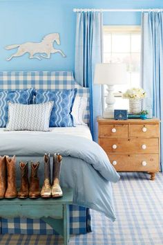 A major wash of blue can feel right as rain. Here, the headboard's large-scale print serves as the j... - Brian Woodcock
