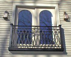 """Juliet Balcony - a railing for safety 36 - 42"""" high - no space to step out onto."""