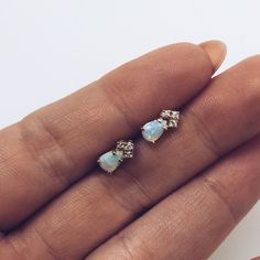 These earrings are beyond! Two pear shaped Ethiopian opals are prong set and each topped with three prong set diamonds. This unique design is a modern twist on the classic opal earrings. - Sold as a p