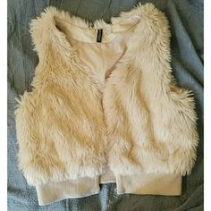 Fur Vest Condition: Lightly used Size: 12 Color: cream/ white   ***Comment ANY questions*** ***Bundling Discount**** *** Offers (Reasonable) Accepted*** H&M Jackets & Coats Vests