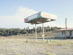 Photographer captures 26 abandoned gasoline stations across America New York Photographers, Space Place, Wind Turbine, Abandoned, Exterior, America, Places, Photography, Creative