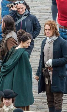 BTS look at Cait's expression and Sam's fist. Not happy about something.