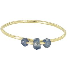 Natural blue sapphires adorn this dainty gold ring. The minimal gold ring is designed as a simple support for the blue sapphire beads. UK design, shop now! Gold Bands, Blue Sapphire, Confident, Turquoise Bracelet, 18k Gold, Colour, Gemstones, Studio, Stylish