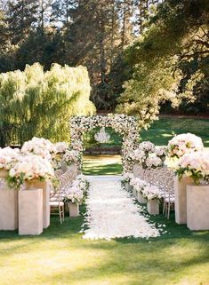 See more of this glamorous wedding ceremony and over-the-top floral arch on Aisle Planner! #glamorouswedding