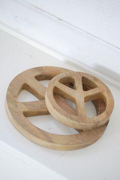 Place your warm pot on a decorative peace sign