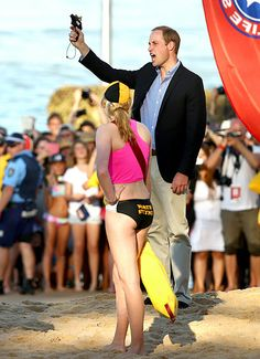 Ready…Set…Go! The Prince shot the start gun to kick off a race on the Manley Beach in Sydney Australia. The race was part of a life-saving event where young members of the local Life-Saving club competed against one another.  Read more: http://www.usmagazine.com/celebrity-news/pictures/kate-middleton-prince-william-prince-georges-royal-tour-of-new-zealand-and-australia-201494/37592#ixzz2zXTlJoIT  Follow us: @Us Weekly on Twitter | usweekly on Facebook