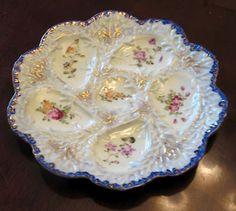 Gorgeous Oyster Plate I saw on the Head Mistress Blog...love the touch of blue...