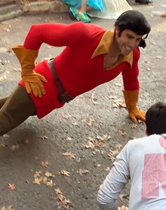 Gaston From Disney World Is Challenged to a Push-Up Contest: Video - Us Weekly