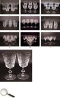An Assorted Group of Bohemian Cut and Etched glasses:  a) set of six glasses  b) set of six goblets  c) group of five goblets  d) set of six glasses  e) two pairs of goblets  f) set of six sorbet glasses  g) group of ten wine glasses  h) group of ten goblets  i) five tulip shaped goblets  j) a pair of heavy cut goblets