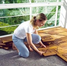 Water resistant wood tiles that snap together and rest on top of hard surface....