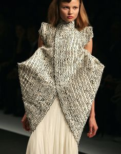 Sculptural Fashion with strong 3D silhouette & monochrome feather textures - shape & structure; wearable art // Alexander McQueen