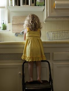 This reminds me of my daughter when she was young...she begged to help do dishes. :)