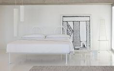 """Bed with a modern trendy design,with an aluminium structure, grey or white. Semi-circular head-board that can be completed with a removable cover // Letto dal design moderno e attuale, con struttura in alluminio verniciata, grigio o bianco. Testata semicircolare che può essere completata da un rivestimento sfoderabile [Double bed / Letto matrimoniale """"Tappeto Volante"""" by Flou] #Beds #Bedroom #Letto #InteriorDesign #HomeDecor #Design #Arredamento #Furnishings #totalwhite #inspiration"""