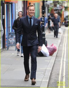 tom hiddleston wears a suit better than anyone else 05 Tom Hiddleston flashes his electric smile while stepping out on Thursday afternoon (September 3) in the Soho neighborhood of London, England.    The 34-year-old…