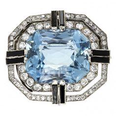 An Art Deco aquamarine, onyx and diamond brooch, circa 1925