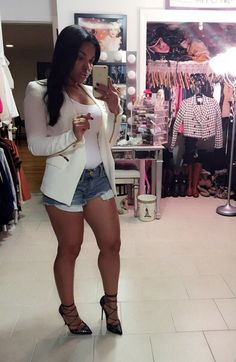 The white blazer is hot...I would have to drop the shorts hemline though.  Love this look