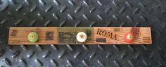 """Modelo """"Roma"""". Realizado en madera de pinotea natural recuperada, transferencia de imágenes y tiradores de cerámica. Medidas: 55 cm. x 6 cm."""
