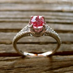 I think I would rock this. Yes, it's pink but it's Sapphire! SECOND FAVORITE, I think. Pink Padparadscha Sapphire Engagement Ring by AdziasJewelryAtelier