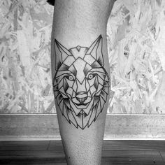 http://clubtatouage.com/wp-content/uploads/2016/06/creative-mens-geometric-wolf-leg-calf-tattoo.jpg