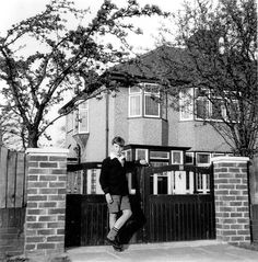 """""""I was different, I was always different. Why didn't anybody notice me?"""" John Lennon, photographed at his childhood home, Mendips, where he lived with his Aunt Mimi"""