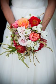 Pretty red, coral and white bridal bouquet, photo by Viera Photographics  | via junebugweddings.com