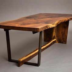Black walnut dining room table with half steel half wood base. This beast slab came out of an old barn storage in upstate michigan, where it had been air drying for 10 years....doesn't get much better then this. It basically had no checks, cracks, twist, just pure air dried walnut perfection. 📷 @cparkphoto
