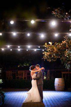 Romantic wedding photo under the cafe lights