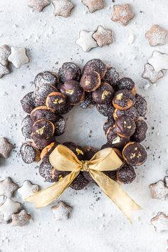 This Chocolate Mocha Profiteroles Wreath is epic in every way as it not only tastes spectacular but looks so eye-catching too. Light, crispy profiteroles topped with dark chocolate and filled with delicate mocha diplomat cream shaped into a festive wreath Profiteroles, Eclairs, Choux Buns, Coffee Milk, Chocolate, Creme, Delicate, Thing 1, Cooking