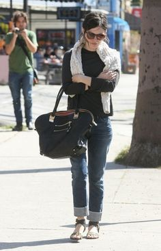 Rachel Bilson, wearing a pair of GOLDSIGN Jenny cuffed jeans in Debut, is papped while leaving a lunch.