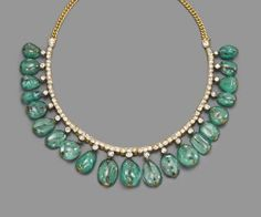 AN ANTIQUE EMERALD AND DIAMOND FRINGE NECKLACE Composed of twenty graduated drilled emerald beads to an old-cut diamond collet surmount and line necklace with curb-link backsection, late 19th century, 38.0 cm. long