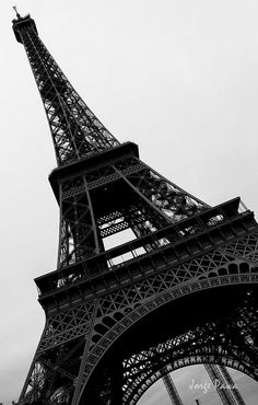 "The Trip Eiffel is genuinely a sign of Paris. It is the most recognizable feature of the city and, in reality, the world. Located in the arrondissement, the Eiffel Tower was a marvel of ""modern-day"" engineering. Black And White Photo Wall, Black And White Wallpaper, Paris Black And White, Beautiful Paris, Paris Love, Torre Effiel, Paris Wallpaper, Paris Pictures, Paris Photography"