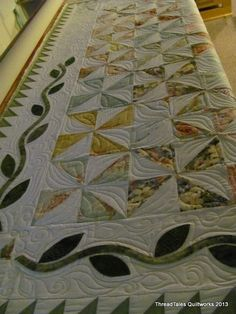 Kathy's Summer quilt...the pattern is from the McCall's quilting mag. and she wanted the quilting to be similar...I could not see from the photo what they had done in the appliqued border so I had ...