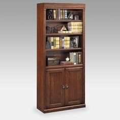 Kathy Ireland Home   by Martin Huntington  Oxford Wood Bookcase with Doors  Burnished Brown  -  $529 @hayneedle